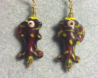 Brown and lime green lampwork fish bead dangle earrings adorned with lime green Czech glass beads.