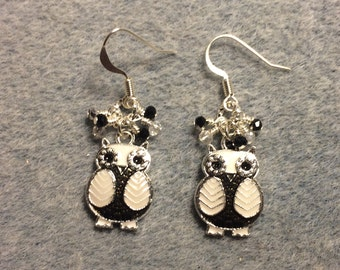 Black and white enamel owl charm dangle earrings adorned with tiny dangling black and clear Chinese crystal beads.