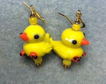 Yellow lampwork duckling bead dangle earrings adorned with yellow Czech glass beads