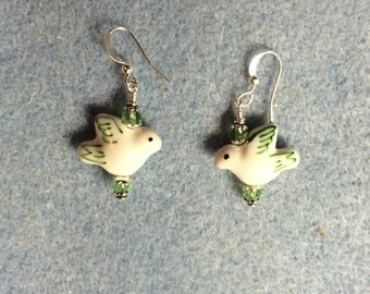Light green and white ceramic dove bead earrings adorned with light green Chinese crystal beads.