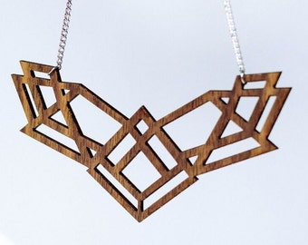 statement necklace in geometric design made of walnut wood