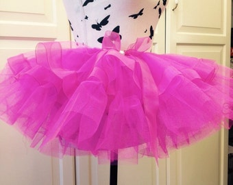 Lovely bright pink Tutu with pink lace around the frill also with a pink bow on the side