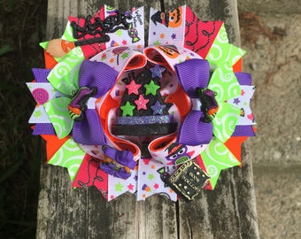 Halloween boutique hair bow with attached barrette in the back.