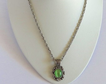 Vintage Antiqued Pendant Scrollwork Design Translucent Apple Green Cabachon in Centre in Silver Tone and Silver Tone Choker Length Chain