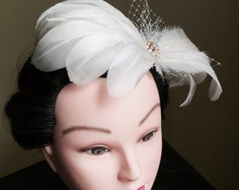 The Swan: ivory feather fascinator with russian veil netting