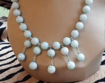 One strand necklace made with faceted amazonite and center drops