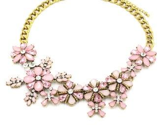 Elegant pink flowers  golden necklace