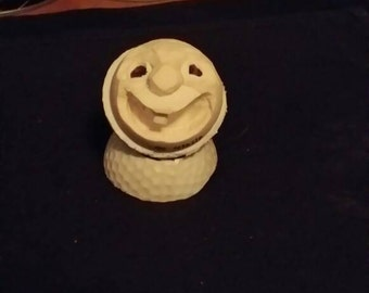 Wee Jimmy. Carved golf ball By Big John