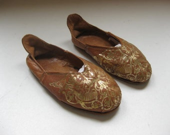 Pair decorative leather children's shoes, slippers with gold print.