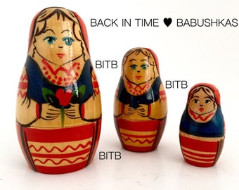 Red & Blue Belarusian BelarusVintage Nesting Doll Holding Single Red Flower. Miniature Brest Region Babushka Dolls, Matryoshka Dolls.