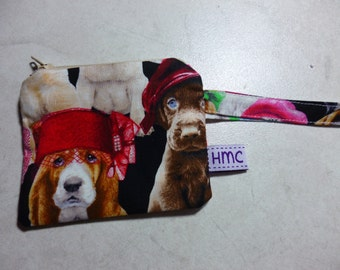 Mini zippered bag.  Pups in hats print. 11cm x 9cm. Fully lined and washable. Ideal for kids lunch money.