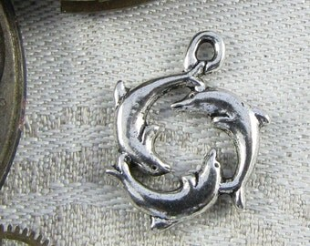 Set of (10) Silver Dolphins Swimming in a Circle Charms 10 per package ANM041