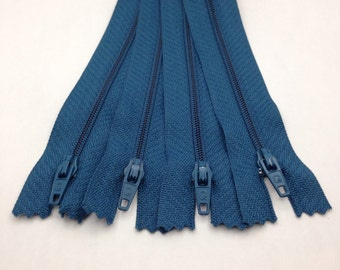 Four pack of 7 inch zippers in Egyptian blue