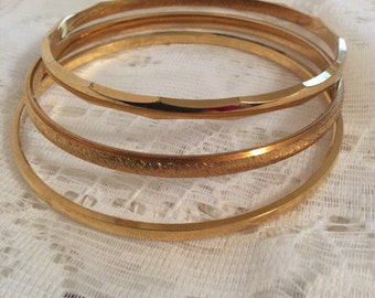 3 thin vintage goldtone Trifari bangles