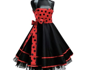 Beautiful dress with dots and a big loop!