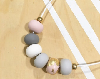 Polymer clay curved bar pendant. Gold, grey and dusty pink  'The Alicia'