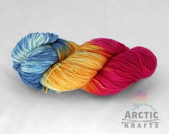 Arctic Sunrise, hand dyed MCN(merino, cashmere, nylon) 80/10/10 sock yarn. 382 yards