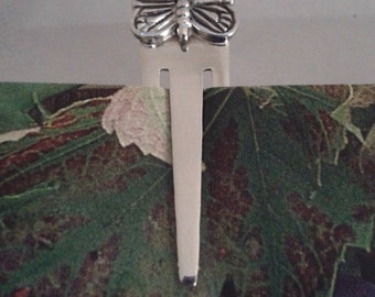 Silver bookmark with butterfly detail at top - reserved