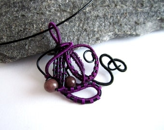 Pendant purple octopus . Wire wrapping in aluminum wire , beads. in twisted wire necklace