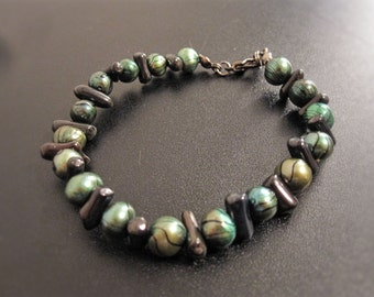 Green pearl and black coral bracelet