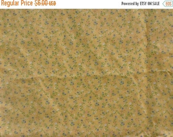 """Yellow cotton fabric with tiny blue, pink and white flowers. By the yard. 44"""" wide."""