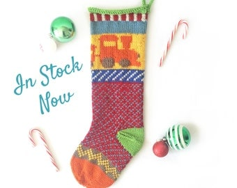 Hand Knit Christmas Stocking with Orange Train, Blue & Red Checker Pattern, and Green Heel. READY TO SHIP!