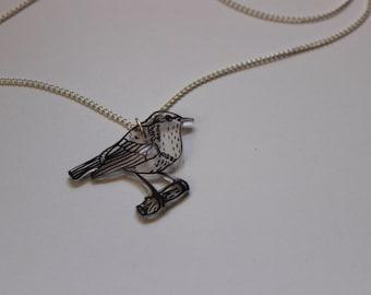 Hand drawn bird pendant