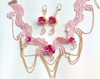 Ornament pink and golden lace, cold porcelain, glass a facets and gold metal