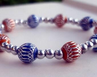 Orange, blue, and silver beaded stretch bracelet/ Silver etched blue and orange beaded bracelet/ Blue and orange beaded bracelet/ Women's