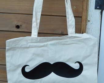 bag in beige canvas with moustache