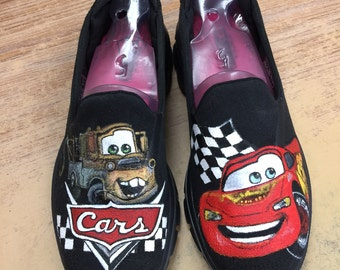 Custom painted shoes with characters from Cars.