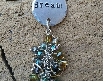 """Dream. Dream necklace. Dreamy necklace. Hand stamped blank that has hammered edges and the word """"dream"""" stamped on it."""