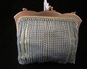 A Ladies Silver Chain with Light Green Satin Evening Purse.