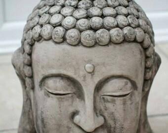 Large stone Buddha head. Buddah statue.