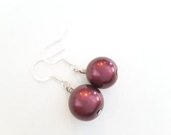 Large Wine Colored Pearls . Earrings