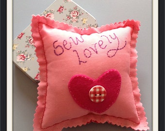 """Pink pincushion Handsewn with the words """"Sew Lovely"""""""