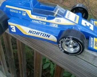 Plastic race car by Gay toys