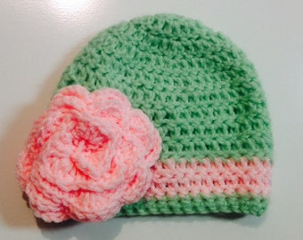 Green Crocheted Hat with Pink Flower