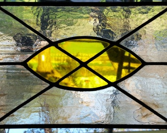Yellow and cloudy clear leaded stained glass panel.