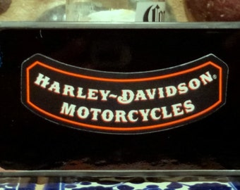 Orange, black and clear beveled stained glass sun catcher with free Harley Davidson sticker.