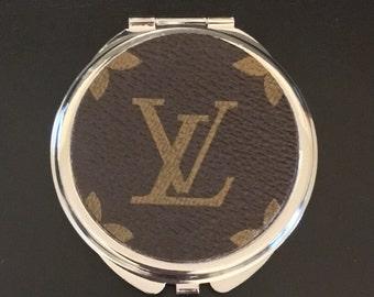 Small silver cosmetic mirror