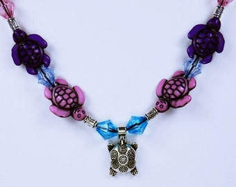 Turtle necklace in pink, blue and purple - silver flowers turtle with turtles beads on a black leather strap