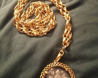 Vintage  crownTrifari glass pendant with long gold toned chain