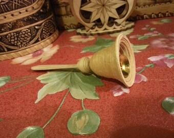 Wooden souvenir bell of birch bark