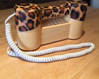 Old phone to dial vintage, old phone to retro antique roulette table beige with leopard fabric