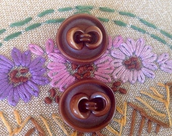 2 Extruded Deco Celluloid Buttons.