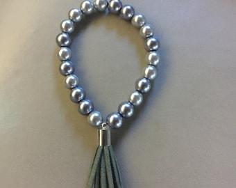 Silver bead bracelet  with green tassel