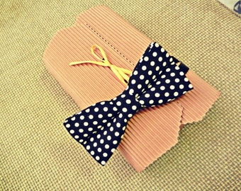Black bow tie with white polka dots