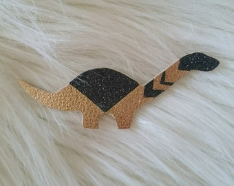 PIN dinosaur Golden leather