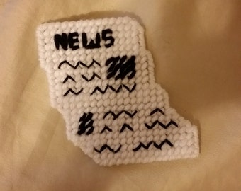Newspaper magnet